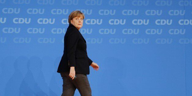 German Chancellor Angela Merkel walks away during a party convention of the Christian Democrats (CDU)...