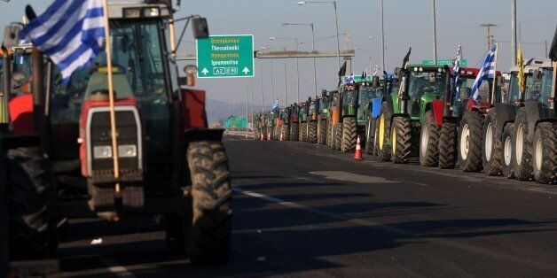 Tractors are parked at the border crossing of Kipoi between Greece and Turkey, northeastern Greece, as...