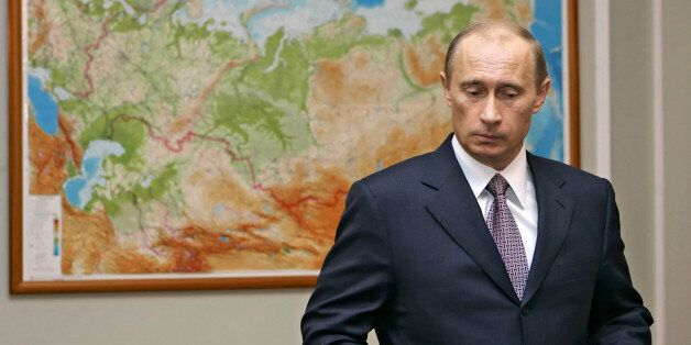 Russian President Vladimir Putin stands in front of a map before a meeting in the Novo-Ogaryovo residence...