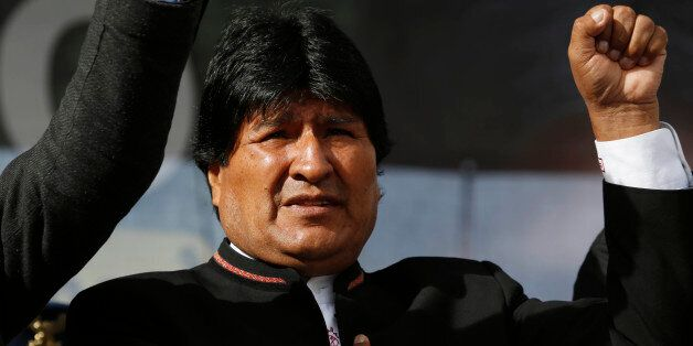 Bolivia's President Evo Morales sings his national anthem at a signing ceremony for the expansion of...