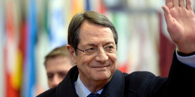 The President of Cyprus Nicos Anastasiades leaves at the end of an European Union (EU) summit in Brussels,...