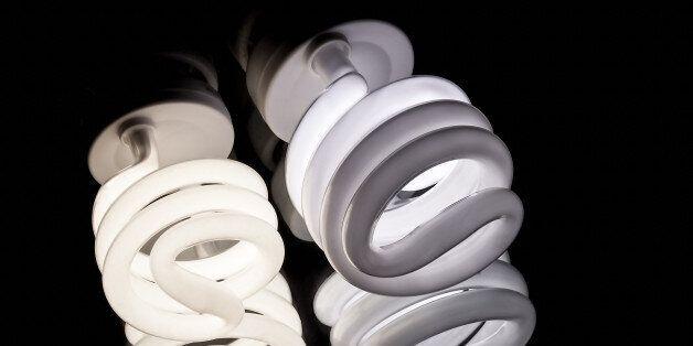 lighted energy saving lamp on a dark