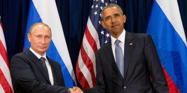 United States President Barack Obama, right, and Russia's President President Vladimir Putin pose for...