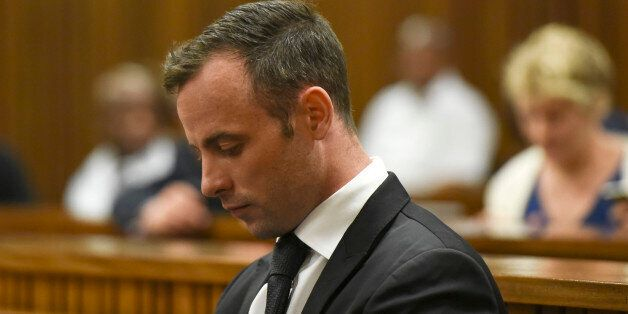 Oscar Pistorius sits in the dock at a courtroom of the North Gauteng High Court in Pretoria, South Africa,...