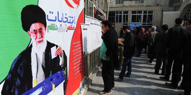 TEHRAN, IRAN - FEBRUARY 26: Iranians line up in long lines to vote in key elections for Parliament and...