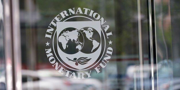 The seal of the International Monetary Fund is seen at the headquarters building in Washington, DC on...