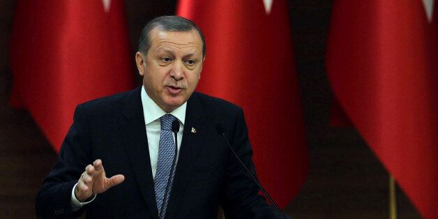 Turkish President Recep Tayyip Erdogan delivers a speech during a meeting of 'mukhtars' (heads of towns...