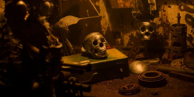 Simulated skulls rest on a table display in a viewing area at the USS Nightmare Halloween attraction...