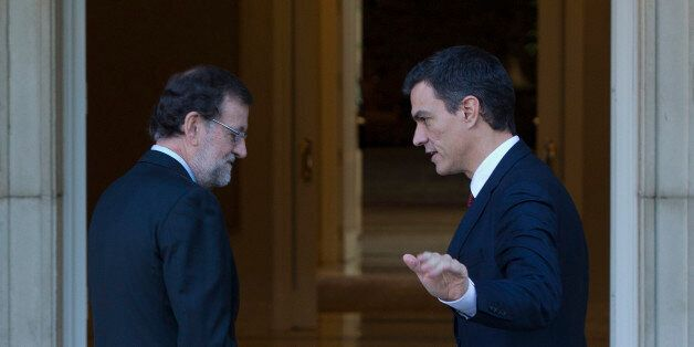 Spain's acting Prime Minister Mariano Rajoy, left and main Socialist opposition leader Pedro Sanchez...