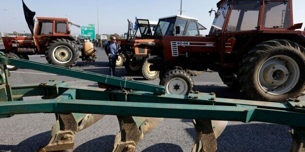 Protesting farmers block a vital point, on a road that links the international airport with the southern...