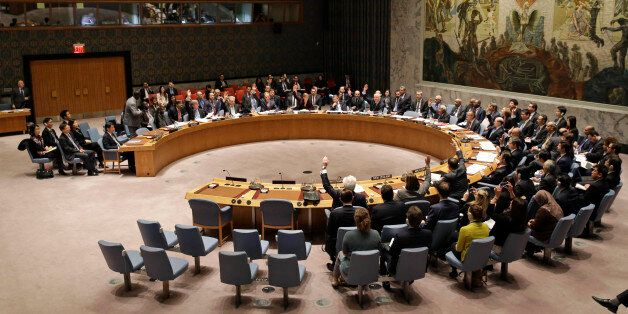 The United Nations Security Council votes on a resolution during a meeting at U.N. headquarters, Wednesday,...