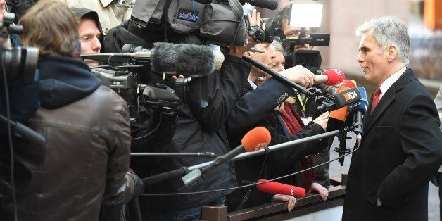 Austrian Chancellor Werner Faymann speaks to the media as he arrives for an EU summit at the EU Council...