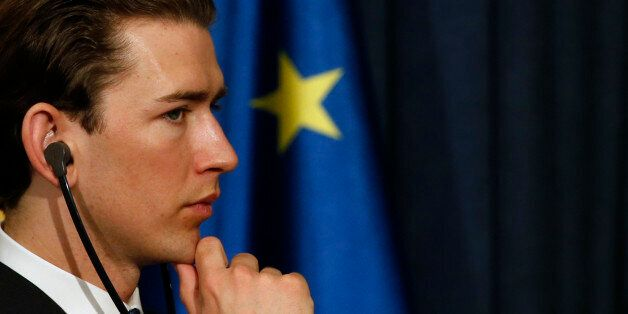 Austria's Foreign Minister Sebastian Kurz listens to a question during a press conference after a meeting...