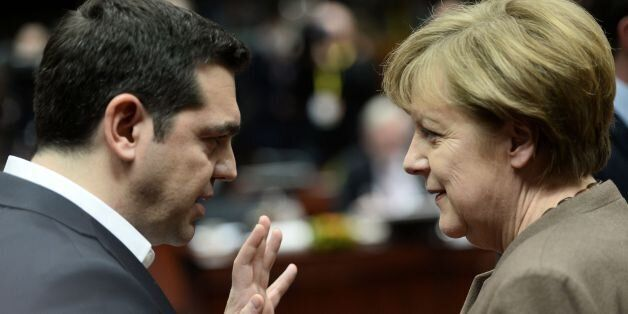 Greece's Prime Minister Alexis Tsipras (L) talks with German Chancellor Angela Merkel during an EU summit...