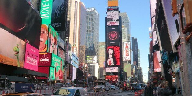 Times Square is a major commercial intersection in Midtown Manhattan, at the junction of Broadway and...