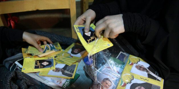 An election campaign worker makes packages of leaflets of a group of conservative candidates in the upcoming...