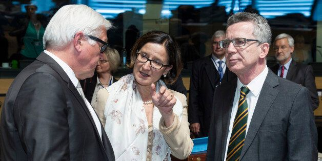 German Foreign Minister Frank-Walter Steinmeier, left, speaks with Austrian Justice Minister Johanna...