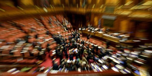 Italian senators attend a debate on the same-sex couples civil union, prior to the final vote, at the...