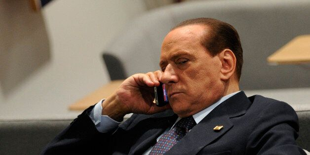 ItalianPrime Minister Silvio Berlusconi phones prior to an European Council at the Justus Lipsius building,...