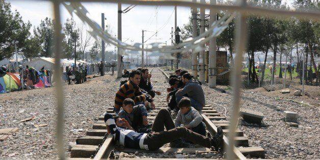 GEVGELIJA, MACEDONIA - MARCH 1: Refugees are seen on a railway at Macedonia - Greece border in Gevgelija,...