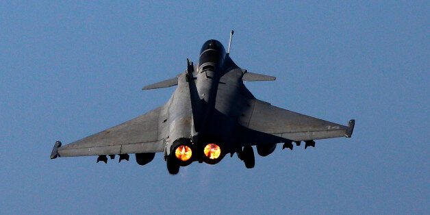 A Rafale fighter jet is catapulted for a mission, on France's flagship Charles de Gaulle aircraft carrier...