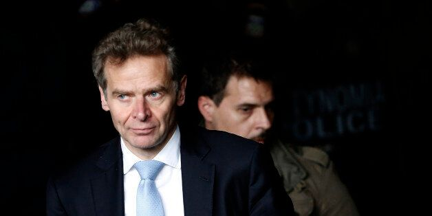 International Monetary Fund (IMF) mission chief Poul Thomsen leaves through an emergency door at the...