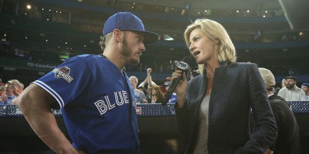 TORONTO, CANADA - OCTOBER 21: Josh Donaldson #20 of the Toronto Blue Jays is interviewed by Erin Andrews...