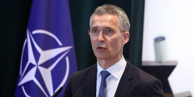 NATO Secretary General Jens Stoltenberg answers media questions during a joint press conference after...