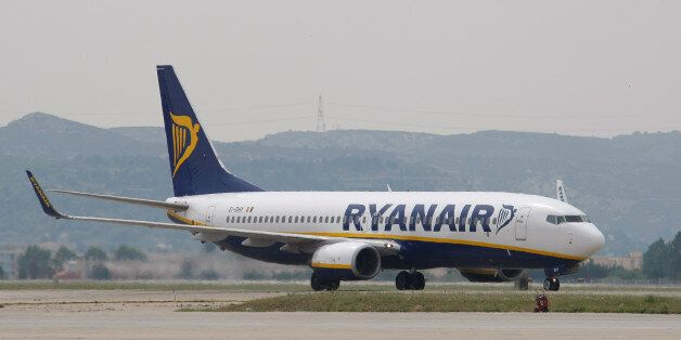 FILE - In this Wednesday, May 13, 2015 file photo, a Ryanair plane lands at the Marseille Provence airport,...