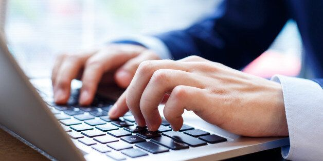 close up view of businessman typing on laptop