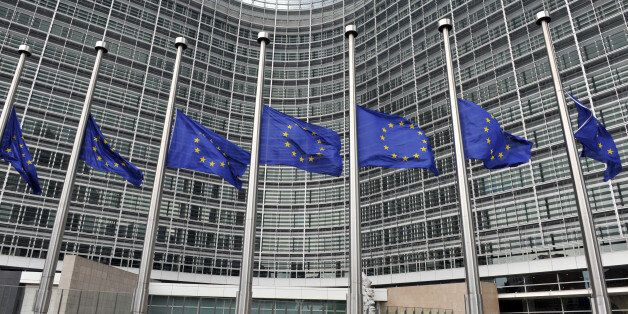 EU Flags fly at half mast in front of the Berlaymont European Commision Bulding in Brussels on April...