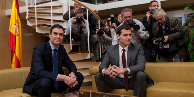 Spain's Socialist Party leader Pedro Sanchez, left, and Ciudadanos Party president Albert Rivera pose...