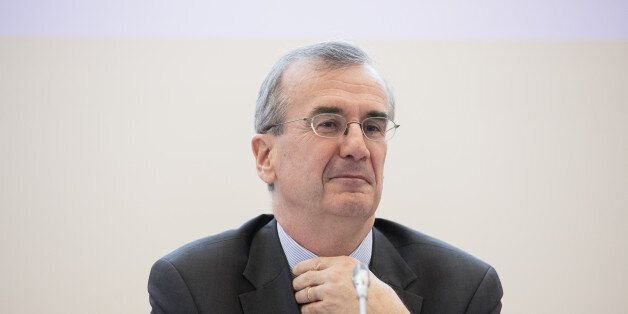 Francois Villeroy de Galhau, governor of the Bank of France, pauses during a news conference as a new...