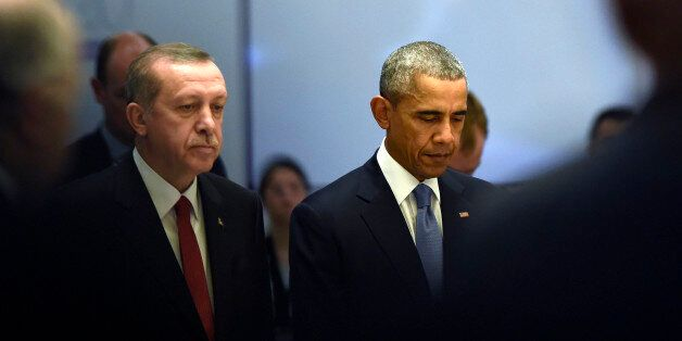 U.S President Barack Obama, right, and Turkey's President Recep Tayyip Erdogan during a moment of silence...