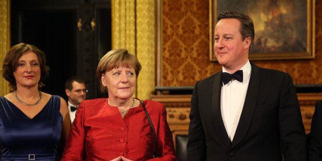 HAMBURG, GERMANY - FEBRUARY 12: Britta Ernst (L) British Prime Minister David Cameron (R) and German...