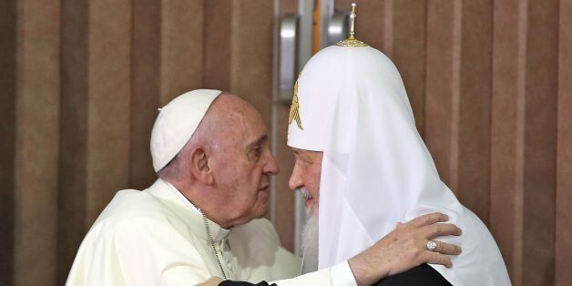 Pope Francis (L) and the head of the Russian Orthodox Church, Patriarch Kirill (R), approach to kiss...