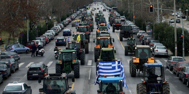 Farmers driving tractors demonstrate against a controversial pension reform in the center of Thessaloniki...