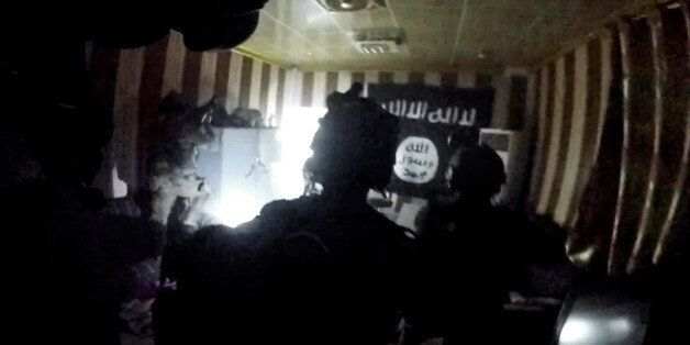 This image made from video taken on Thursday, Oct. 22, 2015 from a helmet camera, shows U.S. and Iraqi...