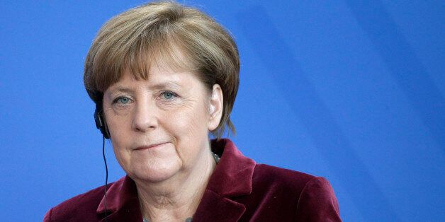 German Chancellor Angela Merkel smiles during a joint news conference with the Prime Minister of Poland,...
