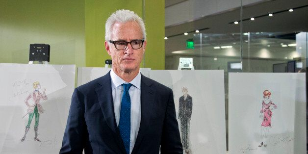 """""""Mad Men,"""" cast member John Slattery who played Roger Sterling, poses with some objects AMC and Lionsgate..."""
