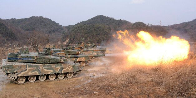South Korean army K-2 tanks fires during a live firing drill at a fire training field in Yangpyeong,...