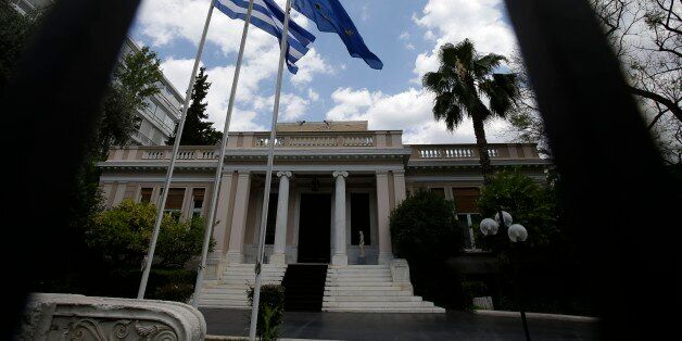 The flags of Greece and European Union flutter outside Maximos Mansion, Prime Minister's office, in Athens...