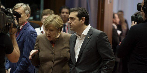 German Chancellor Angela Merkel (L) speaks with Greek Prime Minister Alexis Tsipras (R) before the final...