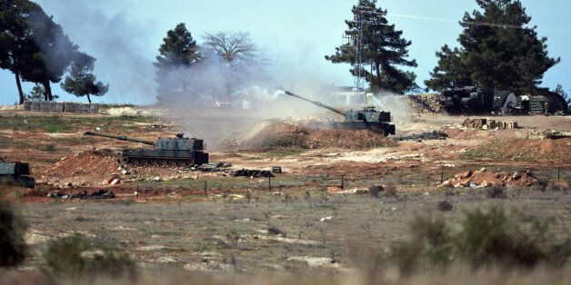 Turkish artillery fire from the border near Kilis town toward northern Syria, in Kilis, Turkey, Tuesday,...