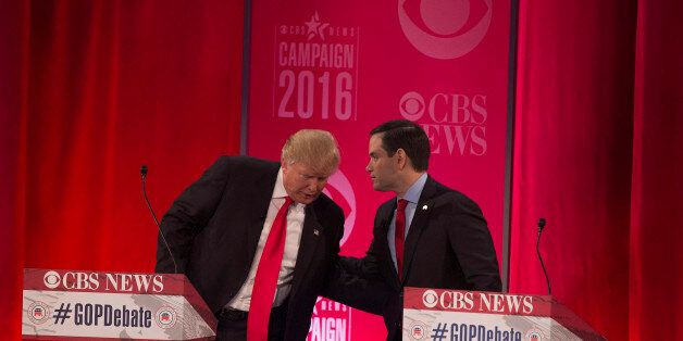Republican presidential candidates Donald Trump (L) and Marco Rubio (R) following the CBS News Republican...