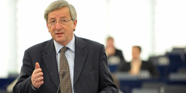 Luxembourg's Prime Minister and President of the Eurogroup Council Jean-Claude Junker addresses deputies...