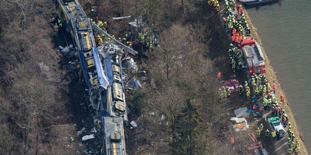 Aerial view shows firefighters and emergency doctors working at the site of a train accident near Bad...