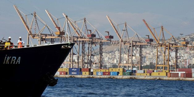 Cranes stand unmanned on a dockside during a strike at the container terminal in Piraeus on October 12,...