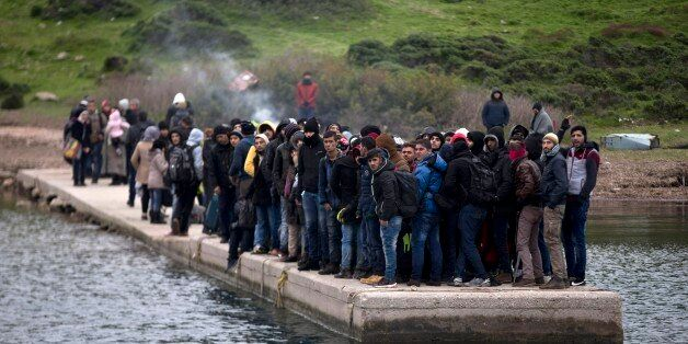 FILE - In this photo taken on Wednesday, Jan. 20, 2016, migrants who have arrived at the shore of the...