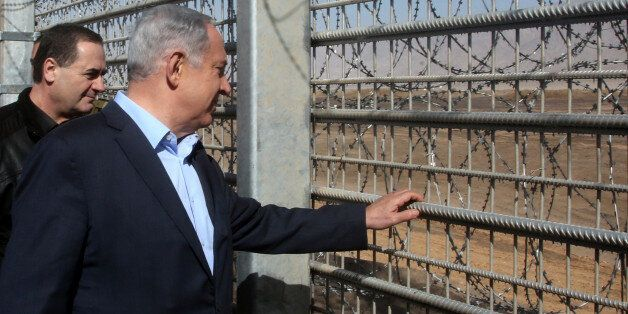 Israeli Prime Minister Benjamin Netanyahu visits the construction site of a new military border fence...